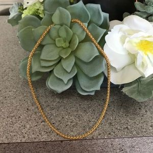 Simplistic yet eye catching Gold tone Necklace.